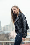 urban girl posing leather jacket rooftop stock images