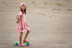 Urban girl ride with penny skateboard Royalty Free Stock Image