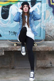 Urban girl with skateboard. Outdoor fashion Royalty Free Stock Image