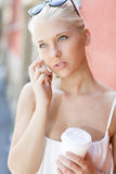 Urban girl talking on the phone in city Stock Photos