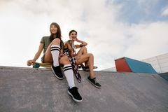 Urban girls in skate park laughing and having fun Royalty Free Stock Photography