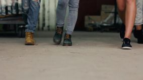 Urban girls with their shoes indoor shot. HD stock video footage