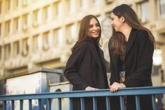 Urban girls walking down the street stock image