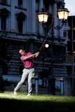 Urban golf. Man playing golf in the city Royalty Free Stock Photos