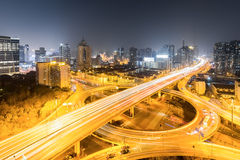Urban grade separation bridge at night. Urban grade separation bridge in shanghai at busy night Royalty Free Stock Images