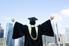 Urban graduate outstretched arms Royalty Free Stock Images