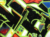 Urban graffiti. Closeup of a wall with abstract painting Stock Image