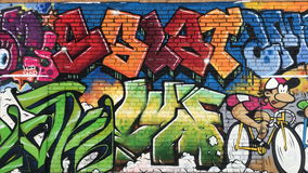 Urban graffiti on a brick wall in the winter. Modern bright urban graffiti on a brick wall in the winter stock footage