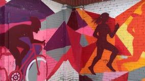 Urban graffiti on a brick wall in the winter. Modern bright urban graffiti on a brick wall in the winter stock video footage