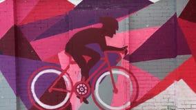 Urban graffiti on a brick wall in the winter. Modern bright urban graffiti on a brick wall in the winter stock video