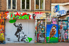 Urban graffiti on the street Spui in Amsterdam Royalty Free Stock Images