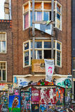 Urban graffiti on a dilapidated house on the street Spui in Amst Stock Photography