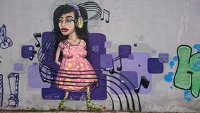 Urban graffiti  - headset music girl portrait Stock Photos