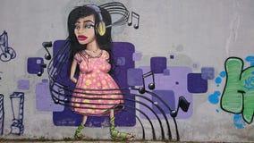Urban graffiti  - headset music girl portrait Stock Photos