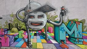 Urban graffiti  - robot graffiti artist Stock Photos