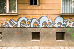 Urban graffiti on walls of buildings Stock Images