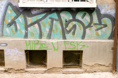 Urban graffiti on walls of buildings Royalty Free Stock Image