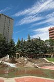 Urban green space. An urban park with pine trees and water fountains. Located in Calgary, Alberta stock images
