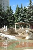 Urban green space. An urban park with pine trees and water fountains. Located in Calgary, Alberta royalty free stock photos