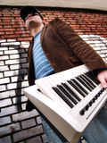Urban Guy with a Keyboard Stock Image