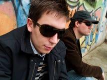 Urban Guys. Over a graffiti wall stock photos