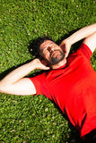 Urban happy sportsman lying on the grass resting Royalty Free Stock Images