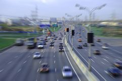 Urban highway. Evening highway of big city with plenty of cars Stock Photo