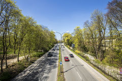 Urban highway divides the english garden in two parts in Munic Stock Photo