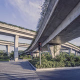 Urban highway overpass covered with plants and copy space for yo. Ur text Stock Photography