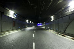 Urban highway road tunnel Stock Images