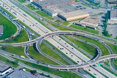 Montreal Canada, aerial view of city highways or roads. Urban highway or road with various ramps forming a circular shape. Aerial view of an everyday Royalty Free Stock Images