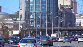 Urban highway traffic on sunny day 4K pan shot, telephoto lens version. Sadovoe ring, Moscow, Russia clip stock footage
