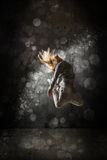 Urban hip hop dancer. Grunge concrete wall background stock image