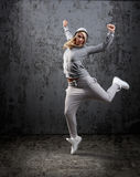 Urban hip hop dancer. Jumping and dancing with hoodie royalty free stock photo