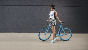 Urban hipster girl with all blue bicycle Royalty Free Stock Image