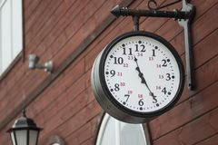 Urban historical architecture with vintage clock in street in London.  Royalty Free Stock Images