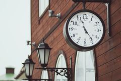 Urban historical architecture with vintage clock in street in London.  Stock Photo