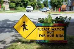 An Urban Homemade Sign. A street sign asking motorists to drive with caution Royalty Free Stock Photo