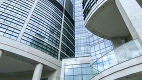 Urban hotel facade reflecting cloudy sky stock footage