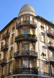Urban house with french windows and balconies Stock Photo