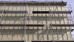 Urban house renovation thermal insulation works. stock video footage
