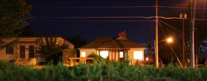 Urban houses at night. Wide angle view of urban houses illuminated at night Royalty Free Stock Image