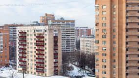 Urban houses in residential district in winter. Urban houses in residential district in Moscow city in winter day Stock Image
