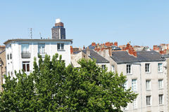 Urban houses and Tour Bretagne in Nantes Stock Photography