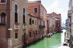 Urban houses on waterfront of canal in Venice Royalty Free Stock Photo