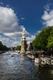 View of Amsterdam canal and tower Royalty Free Stock Photography