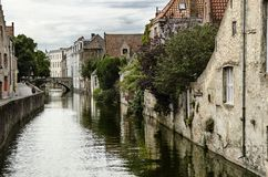 Canal in Bruges, Belgium. Urban image with river canal and old buildings in Bruges Stock Photos