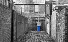 Urban inner city alley. With wheelie bin royalty free stock images