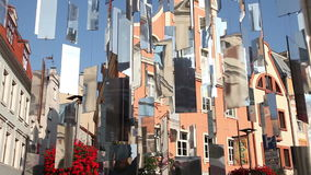 Urban installation with shiny mirrors. Urban installation of shiny mirrors on the background of old houses. Riga, Latvia stock video footage