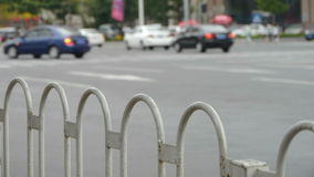 Urban intersection street,railings,fence & cars. Urban intersection street,railings,fence & cars.  gh2_02077 stock footage